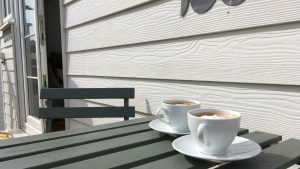 Coffee on the balcony table in the sun.