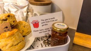 The welcome tray with fresh scones and homemade jam