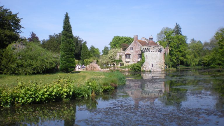 Scotney Castle owned by the National Trust reflected in the water