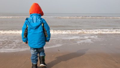 Wrapped up warm for a family friendly winter weekend break at Camber Sands