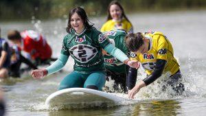 Children having fun paddle boarding at Rye Watersports.