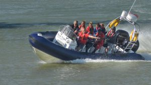 A group enjoying an exhilarating ride with Full Throttle Boat Charters, Rye