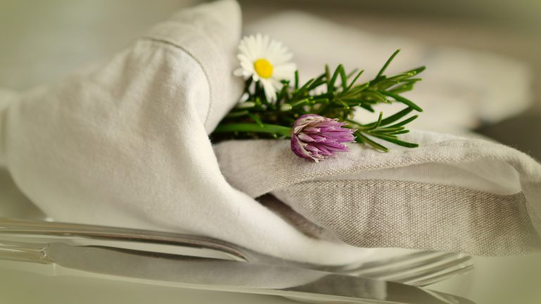 Linen napkin with flowers and cutlery