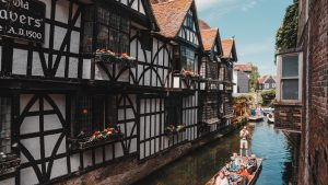 Punting on the river between the tudor houses in Canterbury, Kent