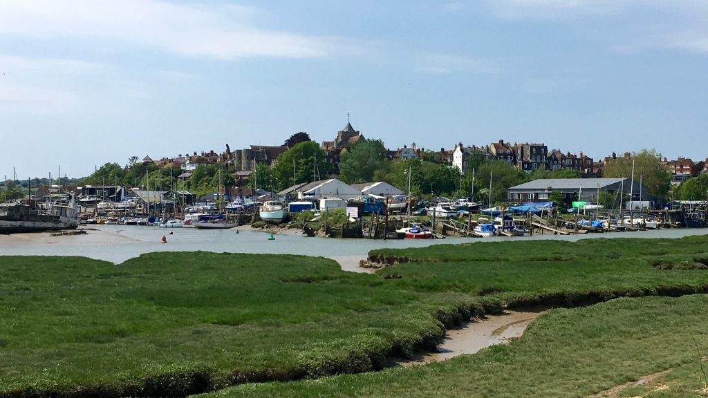 View of Rye from the riverside footpath between Camber Sands and Rye with boats